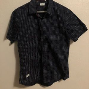 Short sleeved collared button up